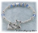 Designs by Debi handmade Personalized Keepsake Bracelet in sterling silver with the name Niko in alphabet letter cubes, sapphire Swarovski crystal birthstones, a heart toggle clasp and a Mom heart charm. Also known as name bracelets, brag bracelets, Mother's bracelets, birthstone bracelets.