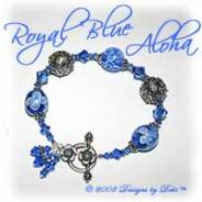 Designs by Debi Handmade Jewelry Royal Blue Aloha Blue Glass Aloha Beads, Bali Silver and Swarovski Crystal Sapphire Bicones Bracelet with a Sterling Silver Round Floral Toggle Clasp