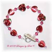Designs by Debi Handmade Jewelry Dark Pink Lampwork, Cat's Eye and Swarovski Crystal AB and Rose Bicones Bracelet with Sterling Silver Heart Toggle Clasp