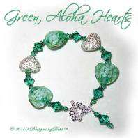 Designs by Debi Handmade Jewelry Green Aloha Hearts Green Glass Hearts, Bali Silver Floral Heart Pillows and Swarovski Crystal Light Emerald Bicones Bracelet with a Sterling Silver Square Floral Toggle Clasp