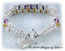 Designs by Debi Handmade Jewelry 2 strand Keepsake Bracelet in the Karen Style Stardust and Seamless Round bead combination with Amethyst (February) and Topaz (November) crystals, a heart toggle clasp and Mom heart charm. Mother's Bracelet