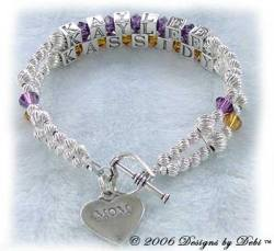 Designs by Debi Handmade Jewelry 2 strand Keepsake Bracelet in the Karen Style Twist bead combination with Amethyst (February) and Topaz (November) crystals, a heart toggle clasp and Mom heart charm. Mother's Bracelet