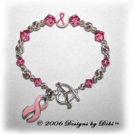 Designs by Debi Handmade Jewelry sterling silver and pink Swarovski crystal awareness bracelet with pink ribbon charm for breast cancer, cleft palate, cleft lip