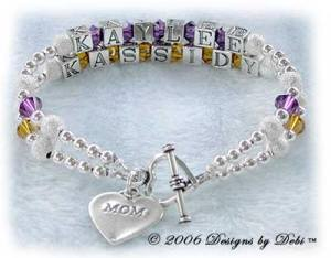 Designs byDebi Handmade Jewelry 2 strand Karen Style Bracelet in the Stardust and Seamless Round bead combination with Amethyst (February) and Topaz (November) crystals, a heart toggle clasp and Mom heart charm.