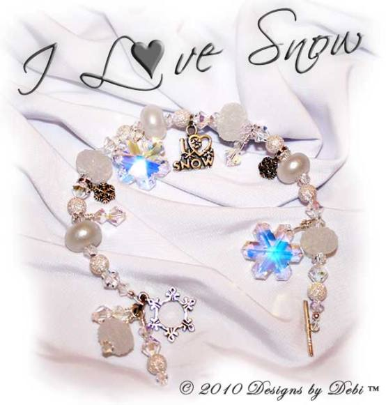 I Love Snow One-of-a-Kind Handmade Bracelet and Earrings Set made with sugar and pixie white artisan handmade lampwork beads, sterling silver snowflakes, Swarovski crystals snowflakes and simplicity and bicones in crystal AB with a sterling silver snowflake toggle style clasp.