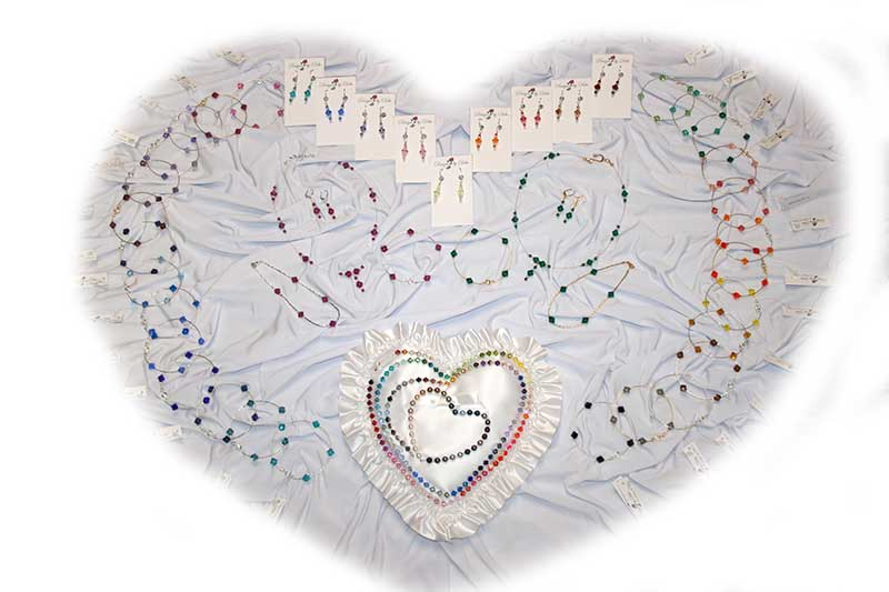 Collection of Designs by Debi™ Signature Collection Jewelry displayed in a heart.