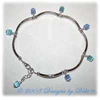 Dangling blue and aqua cat's eye cubes and silver curved tube bead handmade anklet.