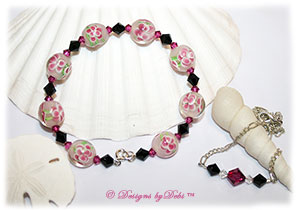 Designs by Debi Handmade Jewelry Aloha Collection Fuchsia and Black Bangle Bracelet and Anklet Set. Features beautiful raspberry aloha floral glass beads, swarovski crystal jet black and fuchsia bicones, a silver spring ring clasp and matching anklet.