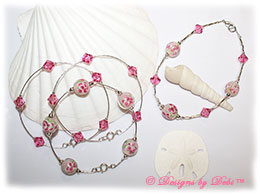Designs by Debi Handmade Jewelry Aloha Collection  Bangle Trio and Anklet Set. Features a trio of silver bangles with pink aloha floral beads and swarovski crystal rose bicones and a matching anklet.