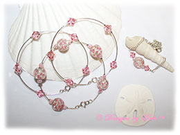 Designs by Debi Handmade Jewelry Aloha Collection  Bangle Trio and Anklet Set. Features a trio of silver bangles with pink aloha floral beads and swarovski crystal light rose bicones and a matching anklet.