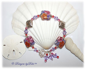 Designs by Debi Handmade Jewelry Aloha Collection Hawaiian Lei Bracelet featuring purple, pink and orange square aloha floral handmade lampwork beads, bali bright silver swirled bead caps and embossed floral diamond-shaped pillows, swarovski crystal violet, rose and padparadscha bicones, multiple dangles and a petite sterling silver flower toggle clasp.