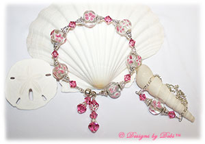 Designs by Debi Handmade Jewelry Aloha Collection Pink Bracelet and Anklet Set. Features large pink aloha floral rondelles, swarovski crystal rose bicones, silver filigree bead caps, dangles, a magnetic clasp and matching anklet.