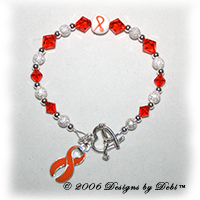 Designs by Debi Handmade Jewelry sterling silver and orange Swarovski crystal awareness bracelet with orange ribbon charm for juvenile diabetes, leukemia, lupus, melanoma