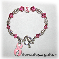 sterling silver and pink Swarovski crystal awareness bracelet with pink ribbon charm