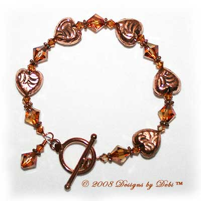 Designs by Debi Handmade Jewelry Copper Embossed Hearts and Swarovski Crystal Copper Bicones Bracelet with a Copper Round Toggle Clasp