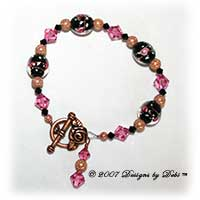 Designs by Debi Handmade Jewelry Copper Stardust, Black Glass with Pink Roses and Swarovski Crystal Jet and Rose Bicones Bracelet with a Copper Rose Toggle Clasp