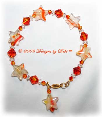Designs by Debi Handmade Jewelry Orange and White Glass Stars and Swarovski Crystal Fire Opal Bicones and Crystal Spacers Bracelet with a Gold Lobster Clasp