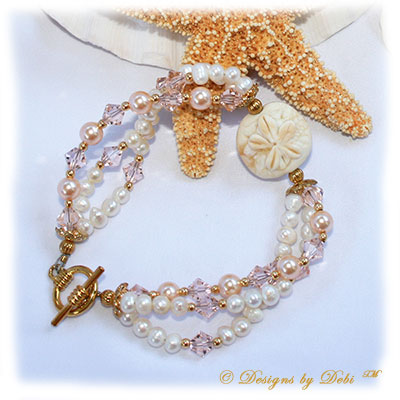 Designs by Debi Handmade Jewelry Sand Dollar Handmade Lampwork Bead, Swarovski Crystal Silk Bicones and Peach Pearls and White Freshwater Pearls Multi-Strand Bracelet with Gold Plated Beads and Round Toggle Clasp ~ OOAK