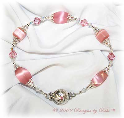 Designs by Debi Handmade Jewelry Pink Cat's Eye Twist and Cube Beads with Swarovski Crystal AB and Light Rose Bicones Bracelet with a Silver and Crystal Magnetic Clasp