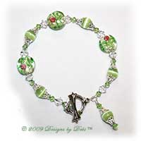 Designs by Debi Handmade Jewelry Lime Green Cat's Eye, Glass Coin Beads with Roses and Swarovski Crystal AB and Peridot Bicones Bracelet with a Silver and Crystal Square Toggle Clasp