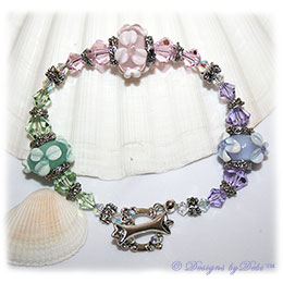 Designs by Debi Handmade Jewelry Lavender, Pink and Mint Green Handmade Lampwork Bracelet with Swarovski Crystal Violet, Rosaline and Chrysolite Bicones, Sterling Silver Plated Flower Spacers, Caps and Swarovski Toggle Clasp ~ OOAK