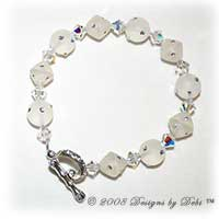Designs by Debi Handmade Jewelry White Resin Round and Bicone Beads and Swarovski Crystal AB Bicones Bracelet with a Silver and Crystal AB Round Toggle Clasp