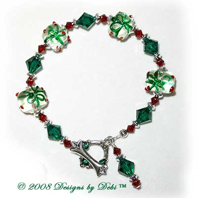 Designs by Debi Handmade Jewelry Red and Green Glass Present / Gift Beads, Swarovski Crystal Siam Red and Emerald Green Bicones and Silver Bracelet with a Square Silver and Crystal Toggle Clasp