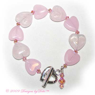 Pink Glass Hearts and Swarovski Crystal Light Rose AB2x Bicones Bracelet with a Silver Heart Toggle Clasp