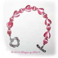 Designs by Debi Handmade Jewelry Pink Cat's Eye Hearts and Round and Swarovski Crystal Rose Bicones Bracelet with a Silver Filigree Heart and Crystal Toggle Clasp