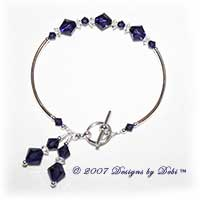 Designs by Debi Handmade Jewelry Swarovski Crystal Purple Velvet Bicones and Crystal Spacers Curved Tube Bracelet with a Silver Round Toggle Clasp