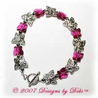 Designs by Debi Handmade Jewelry Silver and Swarovski Crystal Fuchsia Butterflies Bracelet with a Silver Round Toggle Clasp