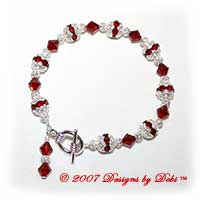 Designs by Debi Handmade Jewelry Swarovski Crystal Siam Red Bicones and Silver Filigree Bracelet with a Silver Round Toggle Clasp