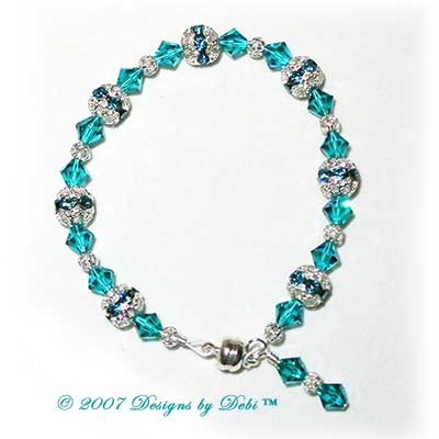 Designs by Debi Handmade Jewelry Swarovski Crystal Blue Zircon Bicones and Silver Filigree Bracelet with a Magnetic Clasp
