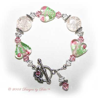 Designs by Debi Handmade Jewelry Pink Crackle, Roses on Hearts and Swarovski Crystal and Light Rose Bicones Bracelet with a Silver Rose and Crystal Toggle Clasp