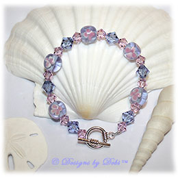 Designs by Debi Handmade Jewelry Tanzanite and Pink Aloha Floral Bracelet with Swarovski Crystal Violet and Rosaline Bicones and a Sterling Silver Plated Round Toggle Clasp