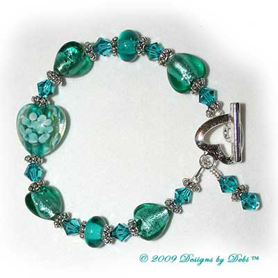 Designs by Debi Handmade Jewelry Teal Hearts and Swarovski Crystal Blue Zircon Bicones Bracelet with a Silver Heart Toggle Clasp