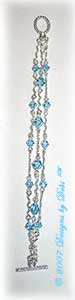 Designs by Debi Handmade Jewelry Silver Squiggles and Swarovski Crystal Aquamarine Bicones Three Strand Bracelet with a Silver Oval Toggle Clasp