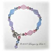 Designs by Debi Handmade Jewelry Pink, Blue and Violet Glass and Swarovski Crystal Bicones Bracelet with a Silver Round Toggle Clasp
