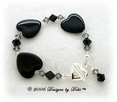 Designs by Debi Handmade Jewelry Black Glass Hearts and Swarovski Crystal Jet, Black Diamond and Crystal Bicones Bracelet with a Silver Heart Toggle Clasp