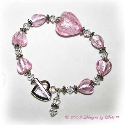 Designs by Debi Handmade Jewelry Light Pink Foiled Glass Hearts and Swarovski Crystal Bicones Bracelet with a Silver Heart Toggle Clasp