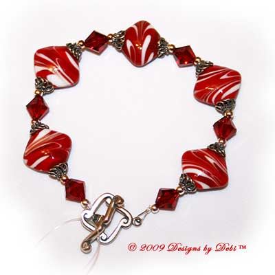 Designs by Debi Handmade Jewelry Red and White Diamond Artisan Handmade Lampwork, Swarovski Crystal Siam Red Bicones and Sterling Silver Bracelet with a Sterling Silver Scrolled Diamond Toggle Clasp ~ OOAK