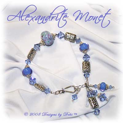 Designs by Debi Handmade Jewelry Alexandite Monet Handmade Lampwork, Swarovski Crystal Alexandrite Bicones and Bali Silver Floral Pillow Beads Bracelet with a Sterling Silver Hook Clasp and Extender Chain ~ OOAK