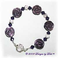 Designs by Debi Handmade Jewelry Purple Cat's Eye Carved Roses, Swarovski Crystal Amethyst Bicones, and Sterling Silver Rose Beads Bracelet with a Sterling Silver Rose Tab Clasp