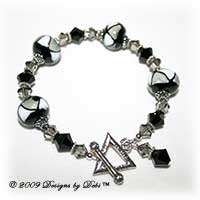Designs by Debi Handmade Jewelry Black, Gray and White Triangles Glass Beads and Swarovski Crystal Jet and Black Diamond Bicones Bracelet with a Sterling Silver Triangle Toggle Clasp
