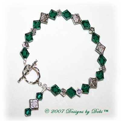 Designs by Debi Handmade Jewelry Swarovski Crystal Emerald Bicones and Silver Celtic Knot Diamonds Bracelet with a Sterling Silver Twisted Round Clasp