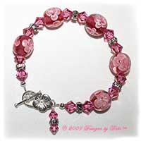 Designs by Debi Handmade Jewelry Wire-Strung Bracelets Pink Aloha Floral Glass and Swarovski Crystal Rose Bicones Beaded Bracelet with Flower Rondelle Spacers and Sterling Silver Flower Toggle Clasp