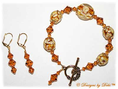 Designs by Debi Handmade Jewelry Aloha Collection Topaz Gold Bracelet and Earrings Set. Features topaz gold lentil and round aloha floral beads, gold bead caps, swarovski crystal topaz bicones, a gold floral toggle clasp and matching earrings.