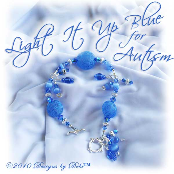 Designs by Debi Jewelry for Charity Piece for April 2010 to raise money for Autism Speaks. A one-of-a-kind artisan handmade bracelet with etched handmade glass lentil beads in a swirled pattern of shades of blue and a hint of violet, swarovski crystal sapphire and sapphire ab2x bicones, sapphire blue cat's eye beads, blue glass barrels, sterling silver twisted double curve and saucer beads and an abstract sterling silver toggle clasp OOAK.