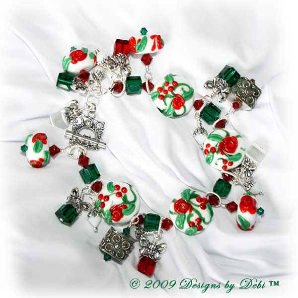 The Perfect Christmas Present Handmade Bracelet made with artisan handmade lampwork beads, Bali silver, Swarovski crystal, and cat's eye with a Bali toggle style clasp.