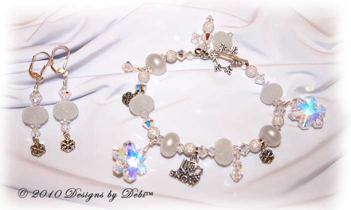I Love Snow Handmade Bracelet and Earrings Set made with sugar and pixie white artisan handmade lampwork beads, sterling silver snowflakes and Swarovski crystal snowflakes and simplicity and bicones with a sterling silver snowflake toggle style clasp.
